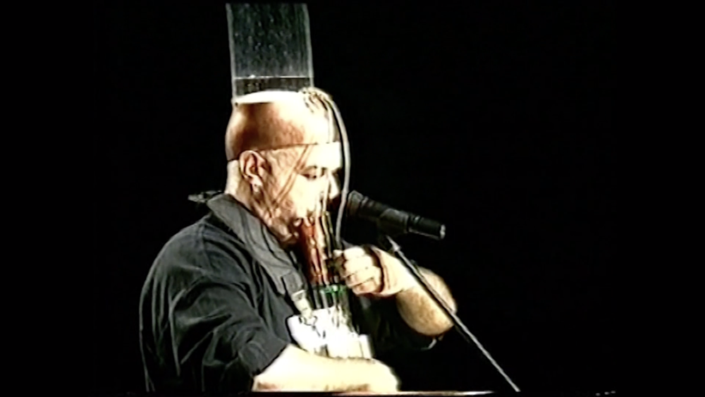 Image from The Frogman's Report Performance Video with Ohad Fishof, 1996