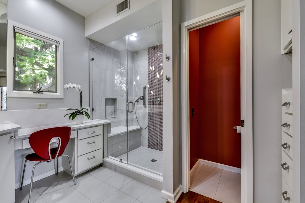 White Bathroom Interior Design with Red Accent Color
