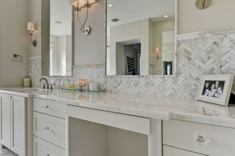 White Bathroom Remodel with Carrara Marble Backsplash