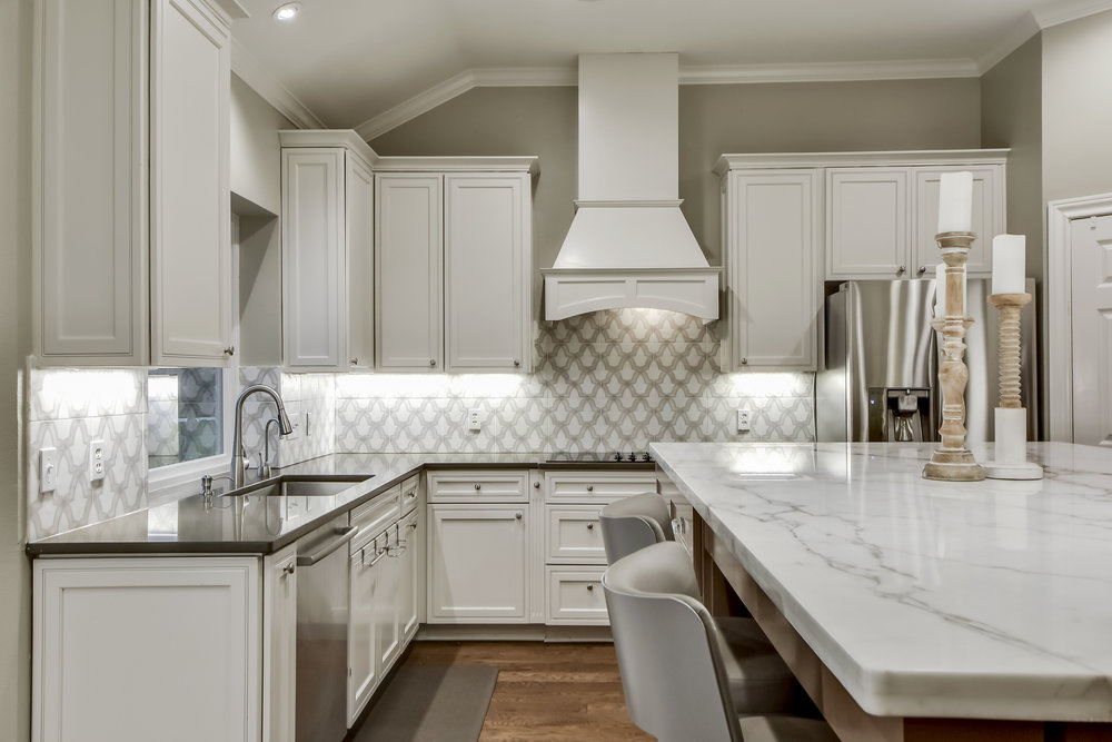 White Kitchen Interior Design with Beautiful Tile Backsplash