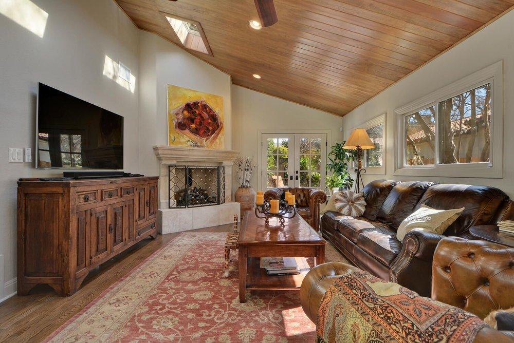Comfortable living room interior design with multicolor area rug