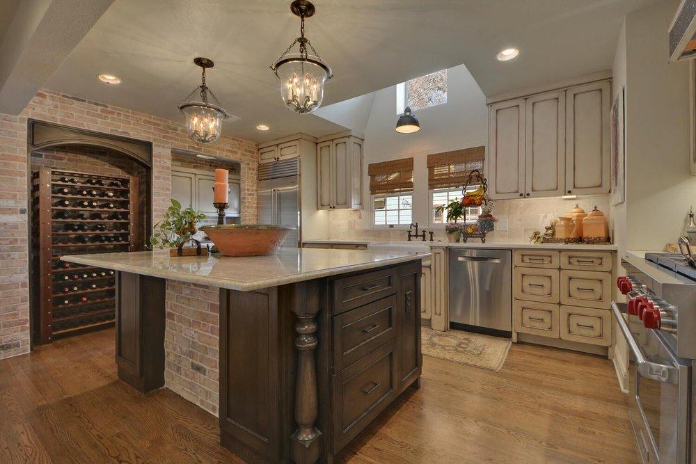 Kitchen center island with chandelier and wine storage