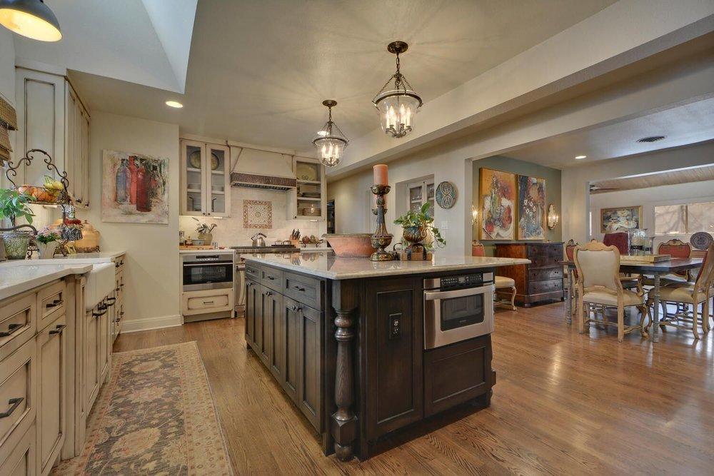 Kitchen design with farmhouse sink and chandelier kitchen island lighting