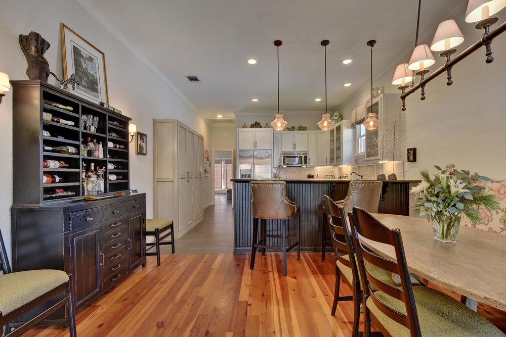 European Living Space with Faux Leather Bar Stools interior design by Next Level Austin