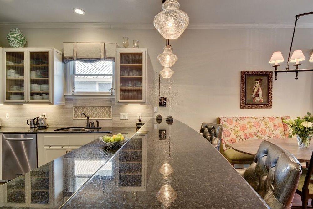 Glass globe pendant lighting over kitchen bar