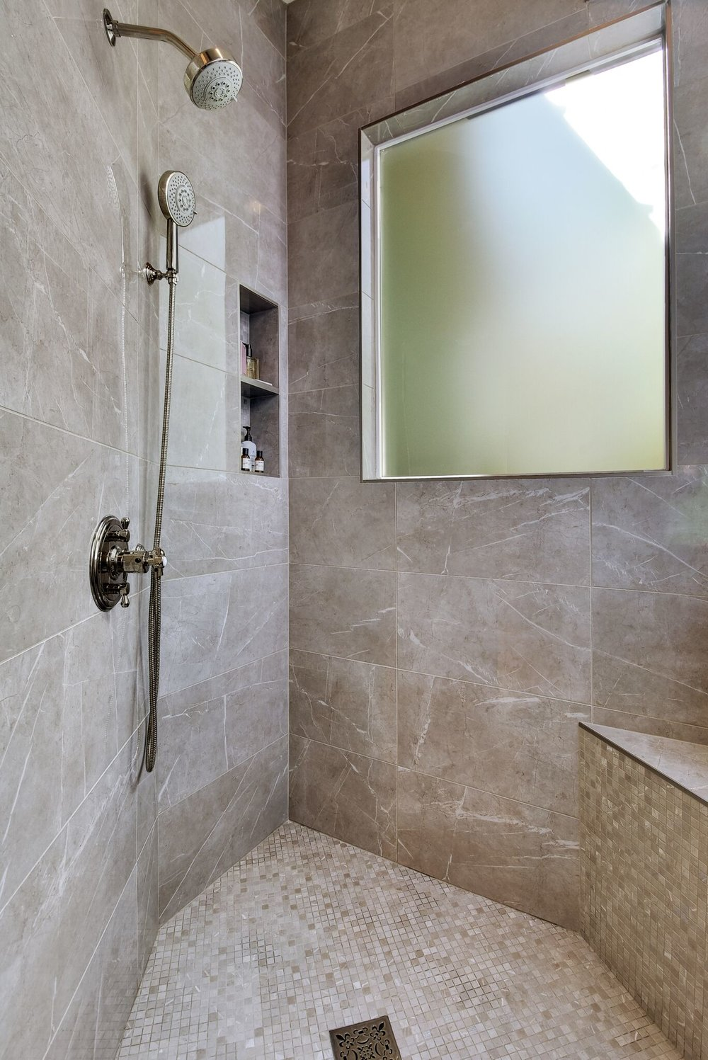 Walk in shower stall with beautiful shower tile