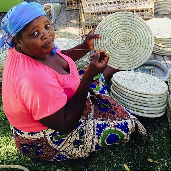 BETTY   I'm 58 years old. I started making baskets in 1981. In 2012 I started working with Mrs. Taylor, working with her has made it possible for me to pay school fees for my children, clothe them and provide food for them. I'm grateful to be working with Mrs. Taylor.