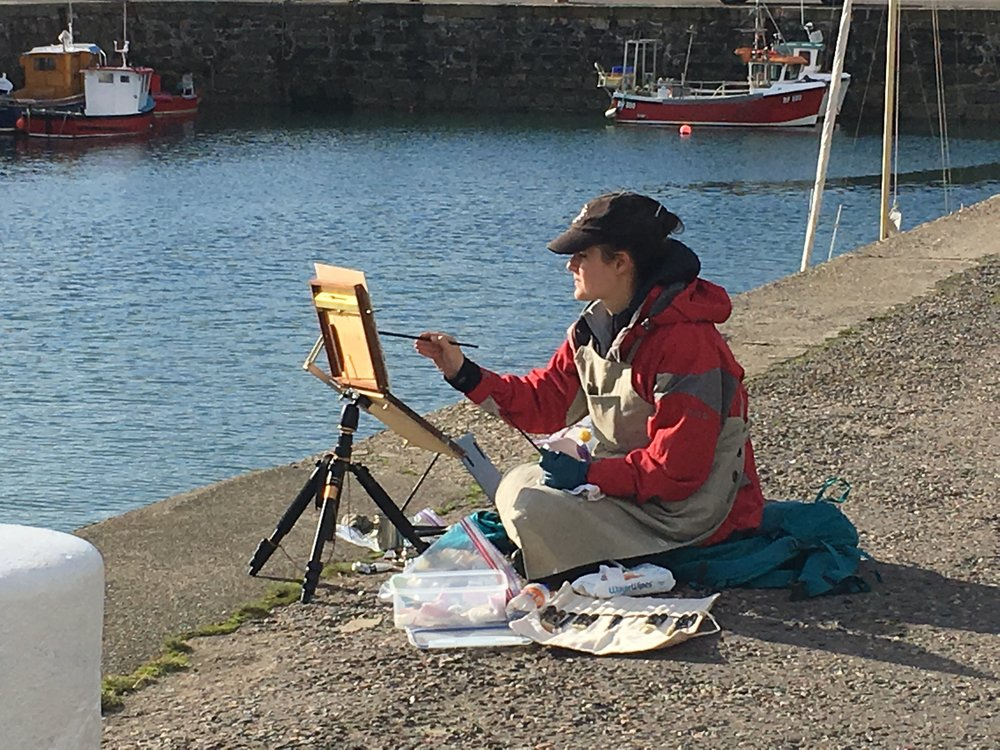 Plein air  painting in a comfy, sunny spot in Portsoy, Aberdeenshire. Photograph courtesy of Valérie Pirlot.
