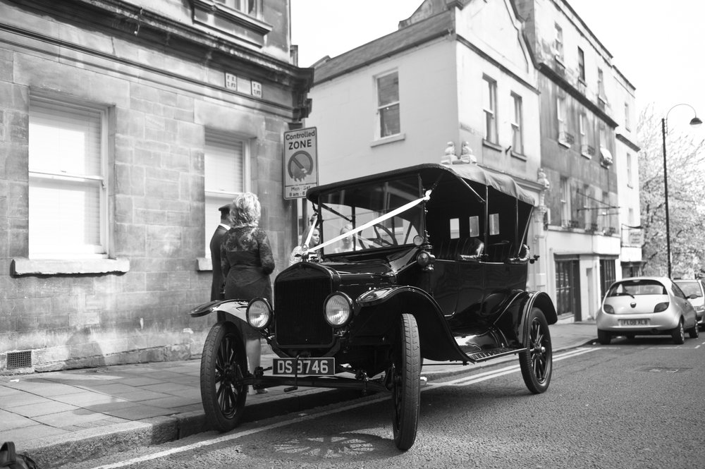 The wedding car is a hand cranked original Ford Model T in, you guessed it, Black. It was tiny, bumpy as buggery and wonderful fun to ride in. A perk of being a photographer, I've been in Jags VDubs Rollers and Bentleys. This is the oldest car I've traveled in though.