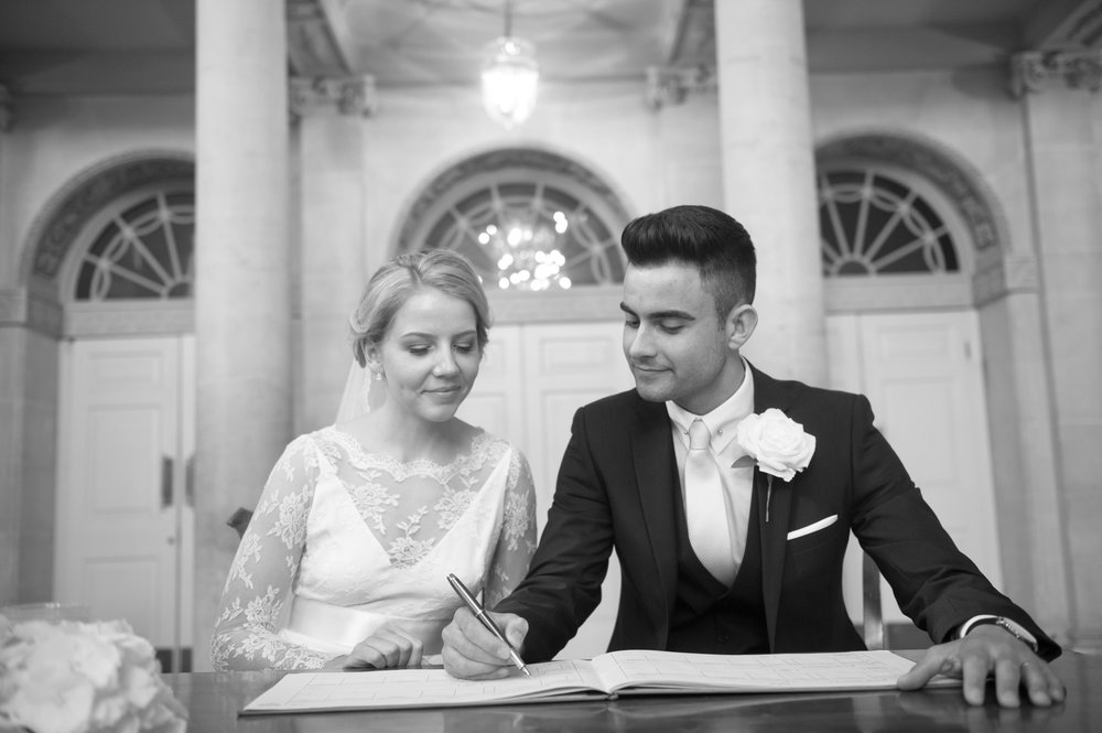 Rosie and Dan are signing the register in this picture which takes place in the Pump Rooms in Bath. Shot in bath before going on the the Royal Crescent and the Roman Baths.