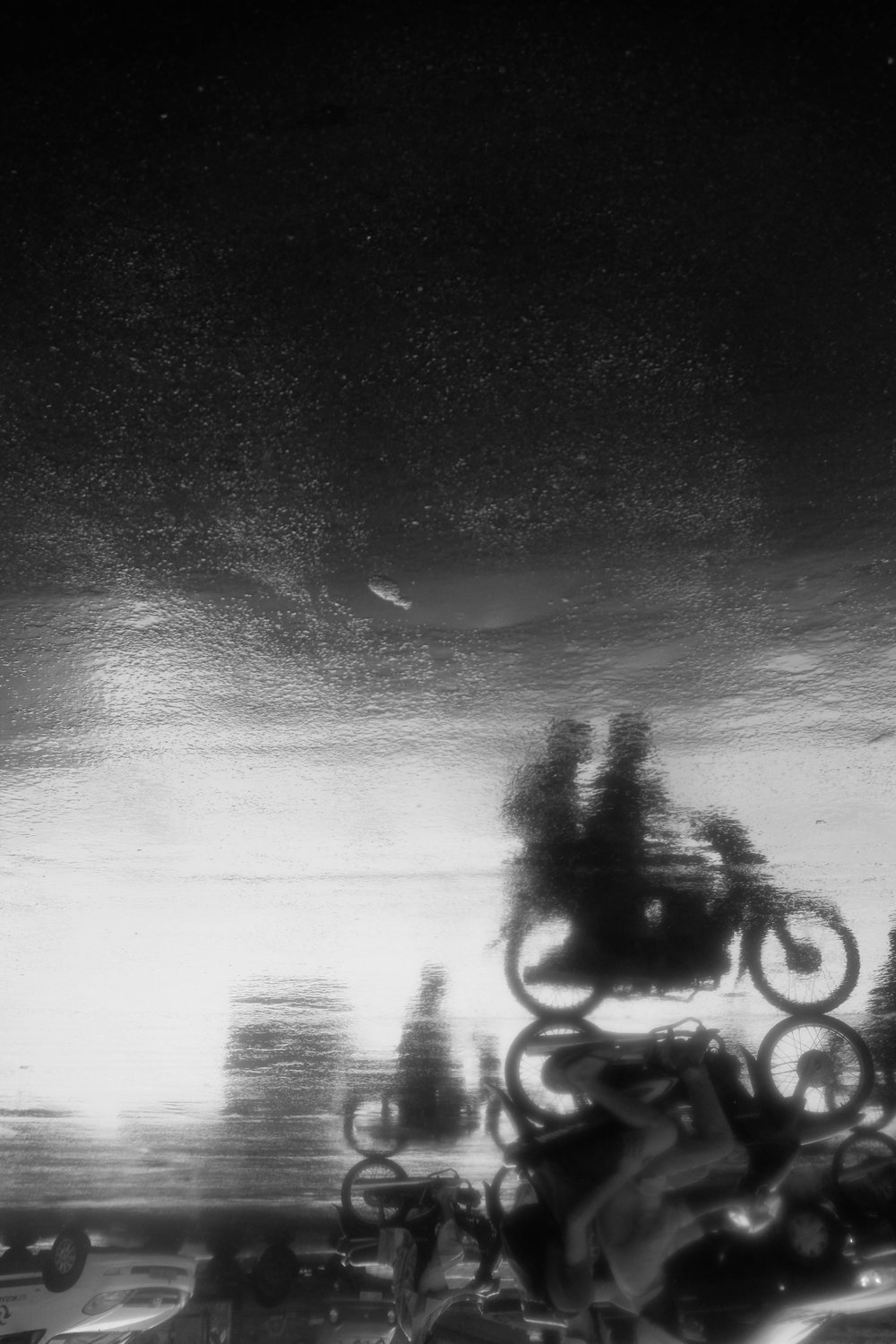 If it absolutely chucks it down I love to go cover my camera and go out barefoot to catch some shots.. there was so much rain in Saigon this day that the roads reflected. I took shots of the reflections and then flipped the photo.