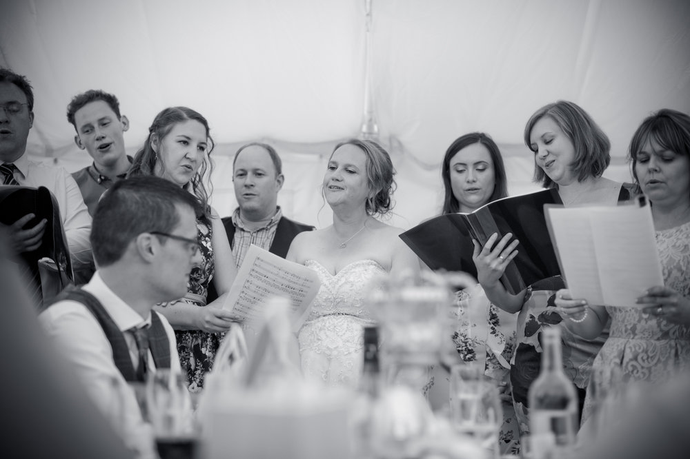 Katy and her team eschewing the traditional wedding speeches for a harmonized wedding song.