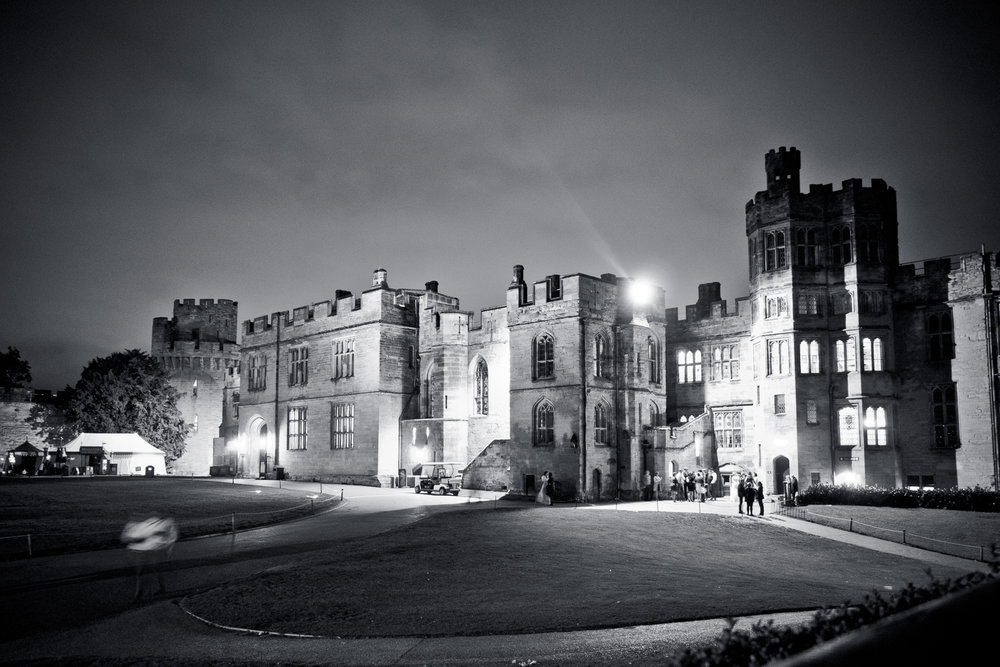open shutter shot of Warwick castle at night during the wedding.