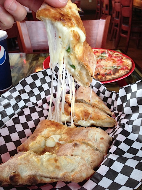Cheese and Jalapeno Stuffed Bread - Mozzarella, parmesan and made in-house garlic brined jalapeños all stuffed into a hand tossed crust and wood-fired until the cheese is hot and gooey. Served with Pi's ranch to put out the flames