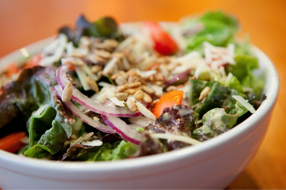 Pi Salad - Red leaf lettuce, roma tomato, parmesan, sunflower seed, red onion with Pi's mustard vinaigrette