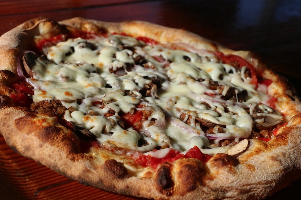 The Classic - Sausage, pepperoni, crimini mushroom, red onion, mozzarella, crushed tomato sauce