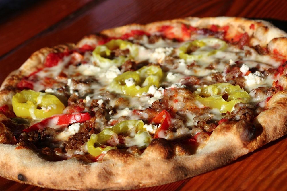 The Twist - Sausage, applewood bacon, roasted red pepper, feta, banana pepper, mozzarella, crushed tomato sauce