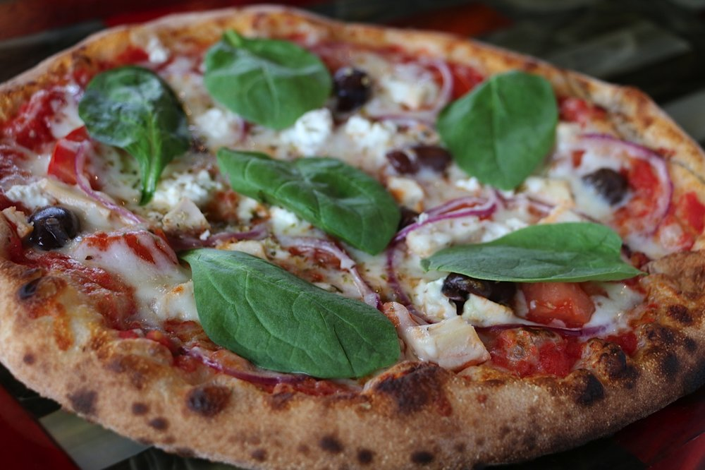 Greek - Chicken, kalamata olive, roma tomato, red onion, oregano, mozzerella, feta, spinach, crushed tomato sauce