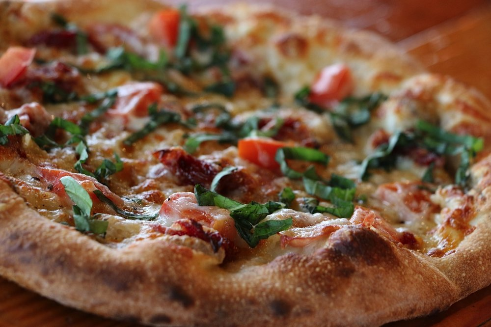 Italian Stallion - Olive oil, prosciutto, roma tomato, crushed red pepper, garlic, sun-dried tomato, basil, cracked pepper, mozzarella