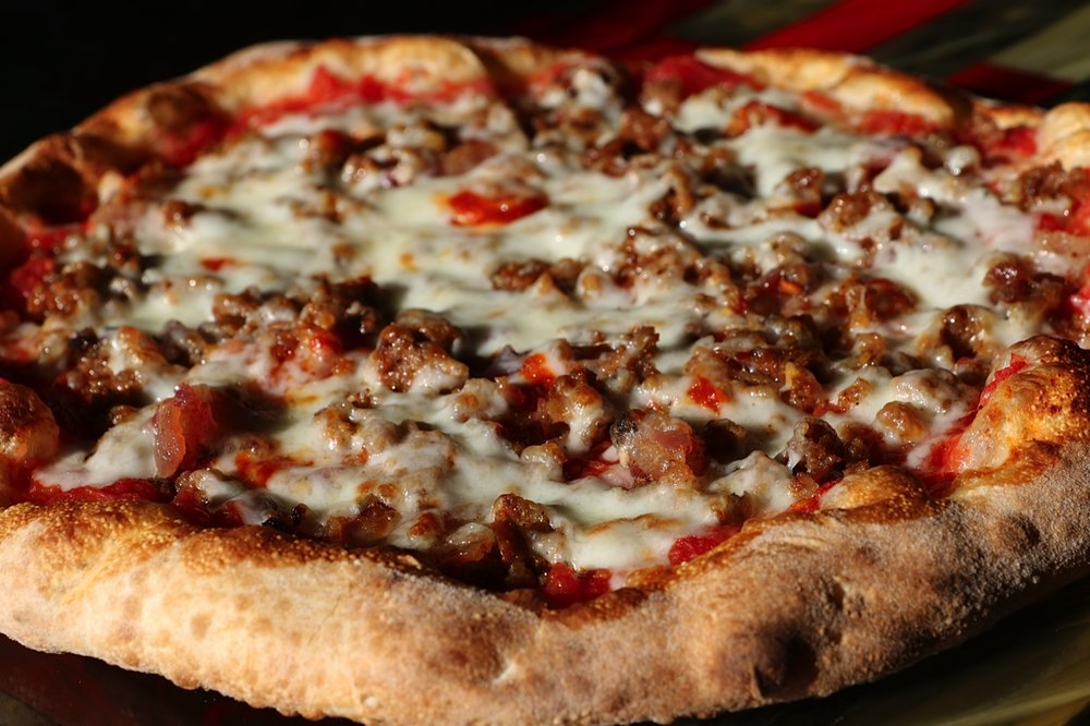 Meat Pi - Pepperoni, applewood bacon, sausage, chorizo,mozzarella, sriracha, crushed tomato sauce