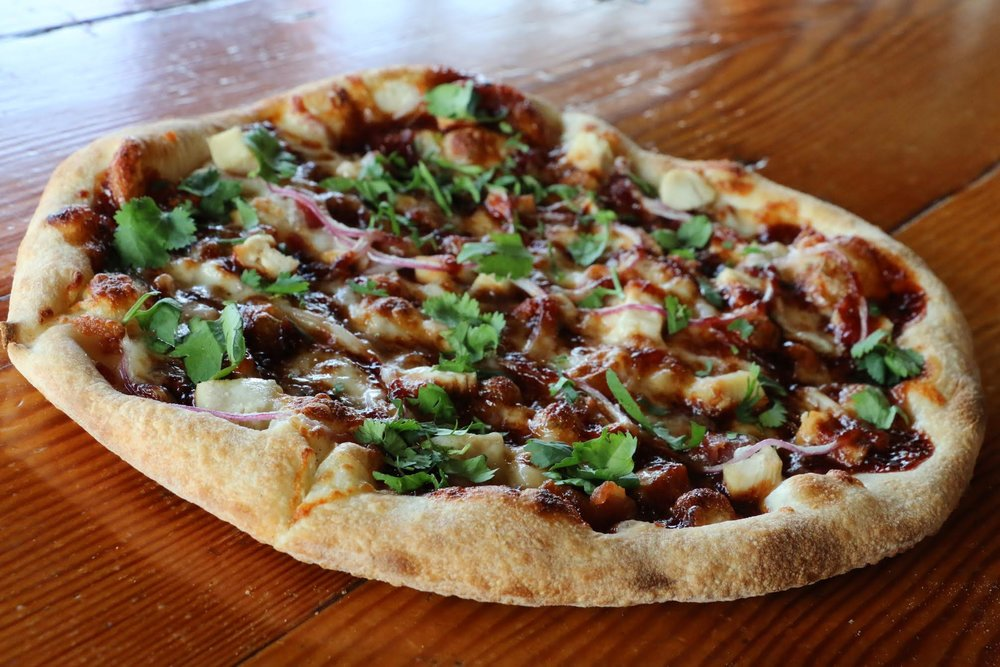 Smokey Dokey - BBQ sauce, chicken, applewood bacon, red onion, cilantro, mozzarella