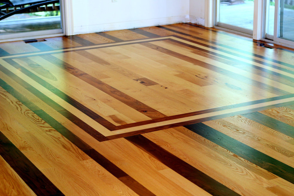 Flooring - Solid hardwood floors add warmth, value and  character, to any room in your house.  Enjoy rustic to modern, bamboo, oak, or walnut to or  exotic hardwoods. Laminate or hard wood can be installed.