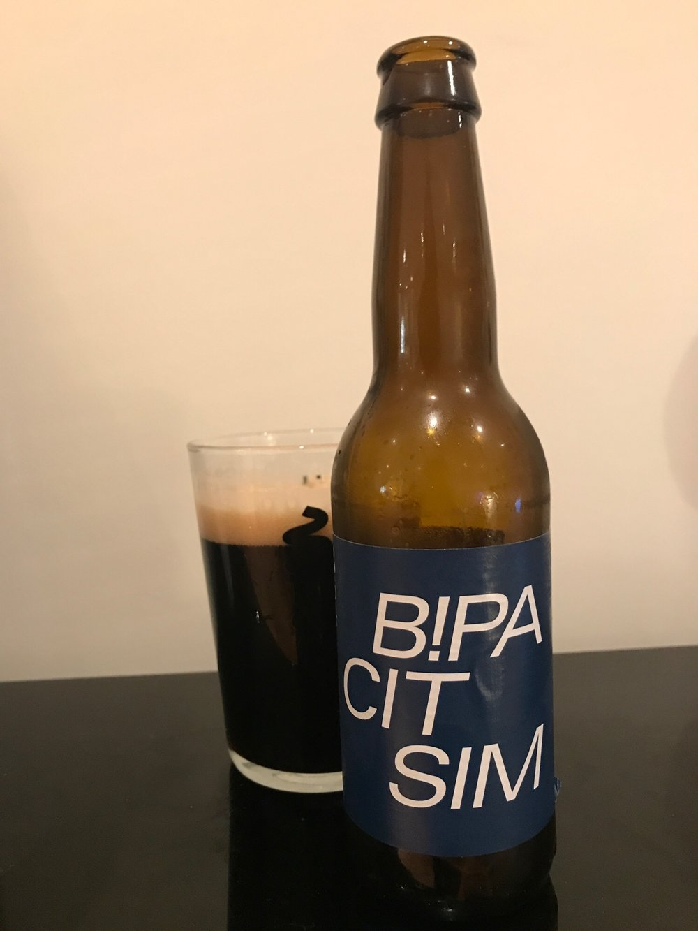 Day Ten: Shock Series - B!PA Citra & Simcoe // Black IPA 7.3% - We've hit double digit days with yet another beer style. This time a punchy black IPA.I never used to understand this style - if I wanted a dark beer I'd have a stout or a porter surely? Why would I want a dark IPA? Past Hedges, you're a bloody idiot. Shut your mouth and drink this.It's a beer that packs in a whole host of flavours and aromas. The roasted malts and added coffee give it a deep, warming, bitter taste but that's contrasted with the fruity hops which makes this surprisingly light and eminently drinkable. It does not feel like drinking a beer that's anywhere near 7.3%.It's weird how dismissive I was of this style of beer considering how varied and interesting it tastes. Maybe my first ever one was guff and I just assumed they'd all be bad. At least I'm not an idiot anymore. Or not as much as one.