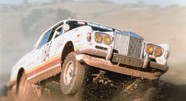 No, your eyes aren't playing tricks on you, that really is a Rolls Royce jumping in a desert.