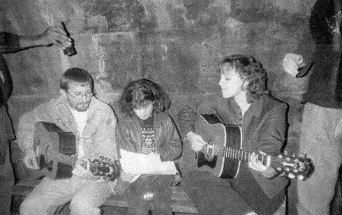 Worshiping under a bridge near Schenley Park where several of the homeless had a camp. (2000)