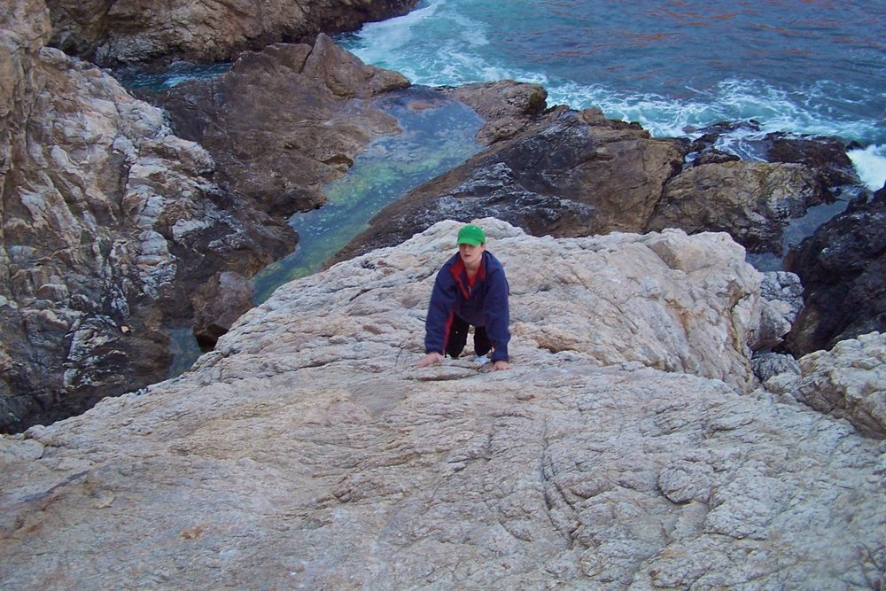This is a terrible photo. It is grainy and blurry and I look pretty goofy. But I am climbing--none too happily as you can see by my expression--to an unknown summit. I think it is a perfect illustration for where God has me as I begin my 4th decade. Here's praying I don't tumble back down and break something.
