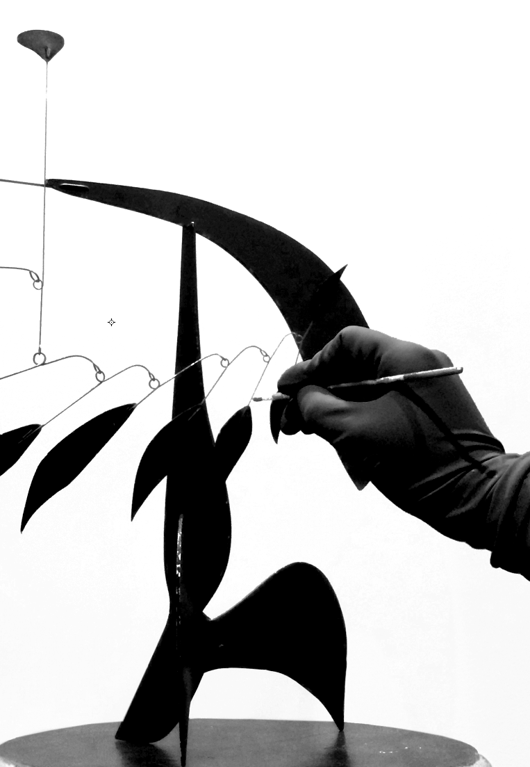 Chanduví touching up a  Calder Mobile , 2015
