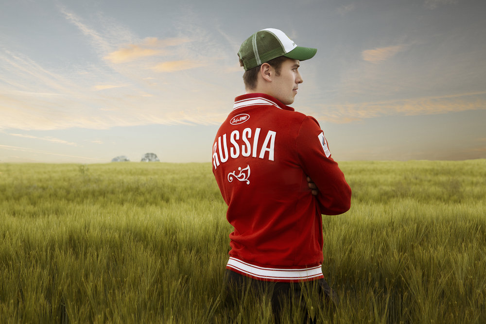 Russian hockey player Maxim Trunev poses in a wheat field toward the end of the Locomotive Yaroslavl training camp in Amish country in Pennsylvania.