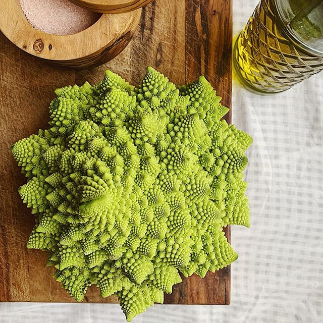 Romanesco broccoli. It's the weirdest, most beautiful, intricately detailed vegetable. Tastes a bit like broccoli and cauliflower all in one! Have you tried it?? - It's typical for us to go to the grocery store and grab a new product, brand of nut butter, or flavor of bars, etc. But when was the last time you grabbed a fruit or vegetable you haven't tried before?! Find something new this week and go for it! It's okay if it doesn't turn out right... I'm sure there's a granola bar flavor you haven't loved before! - We love quartering our romanesco and roasting it on 385 in just olive oil, salt, pepper! - Let me know if you try anything new!