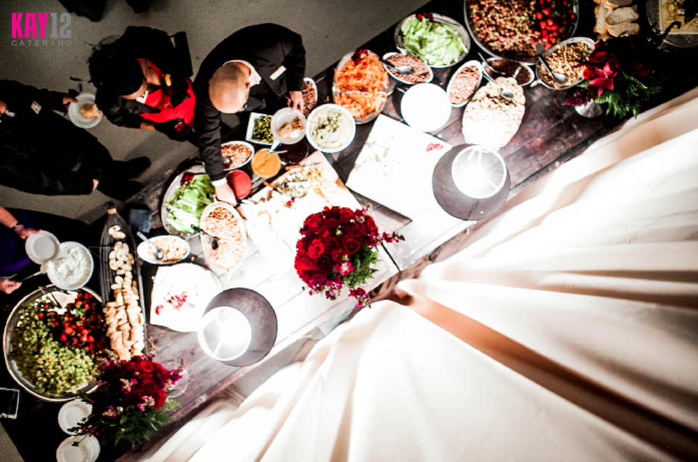 KAY12_photos_action-shots_watermarked_overhead-buffet-people.png