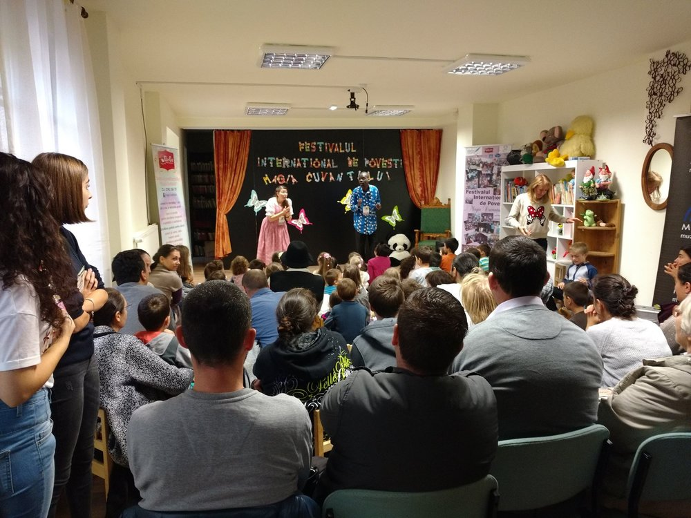 Titi is sharing stories in Romania at  St. Nicholas and Braila library with interpreters