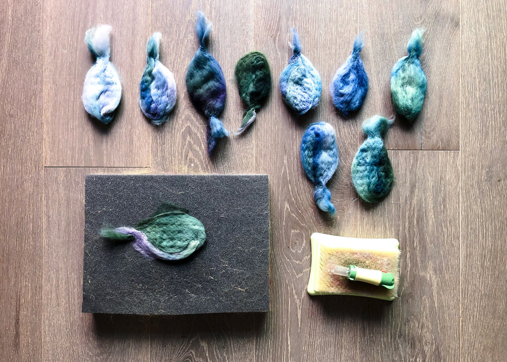To shape the wool into the leaves, I use a needle felting tool.