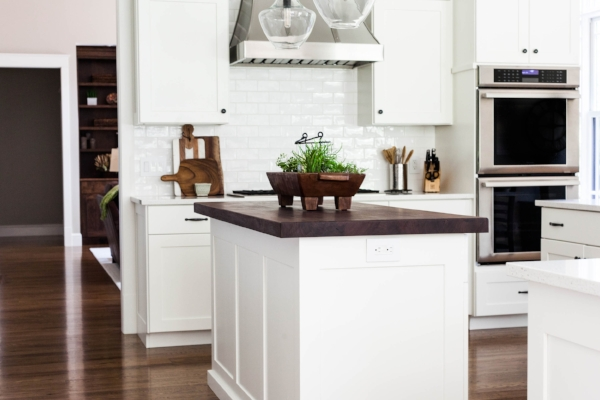 If you've chosen white cabinets, go for a wood floor in a neutral brown (walnut) stain. This is a beautiful timeless look which will carry you through any decorating trend for years to come.