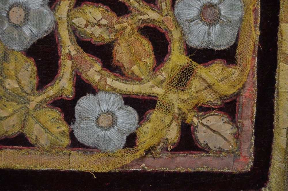 Detail of the old yellow net being removed from the seat embroidery
