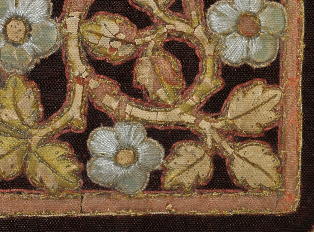 Detail of the original seat embroidery, after conservation