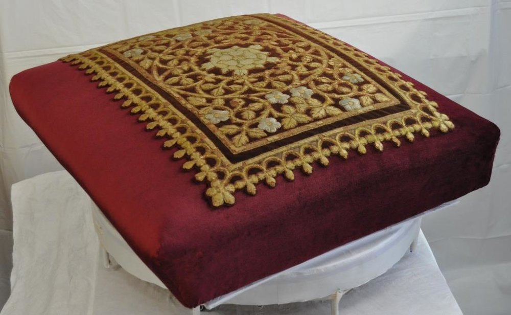 The embroidered seat unit, after conservation treatment