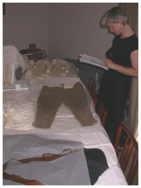 Carrying out a condition survey of of a 19th century gentleman's outfit