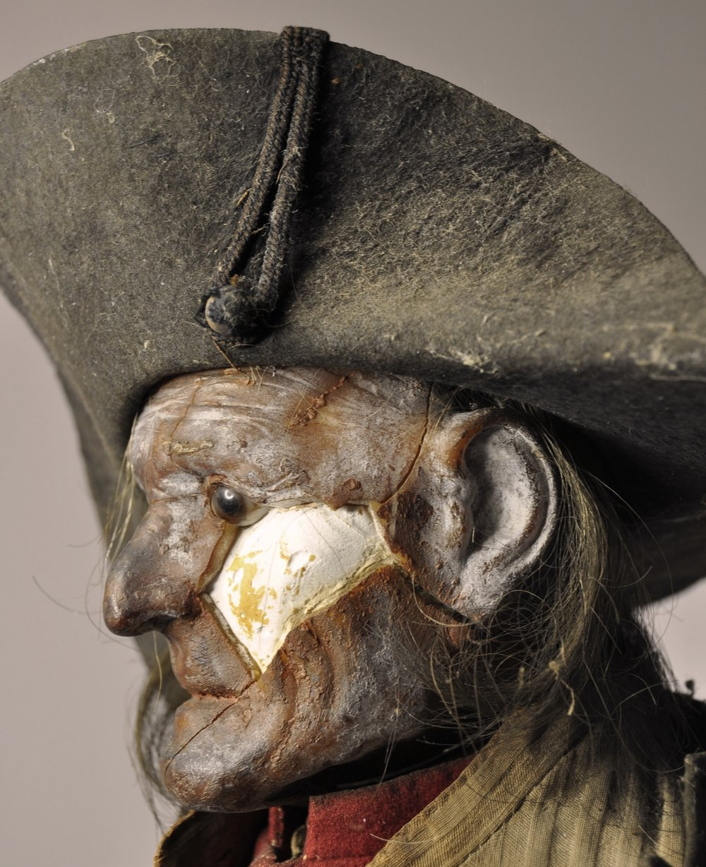 Detail of the head and hat, before conservation treatment
