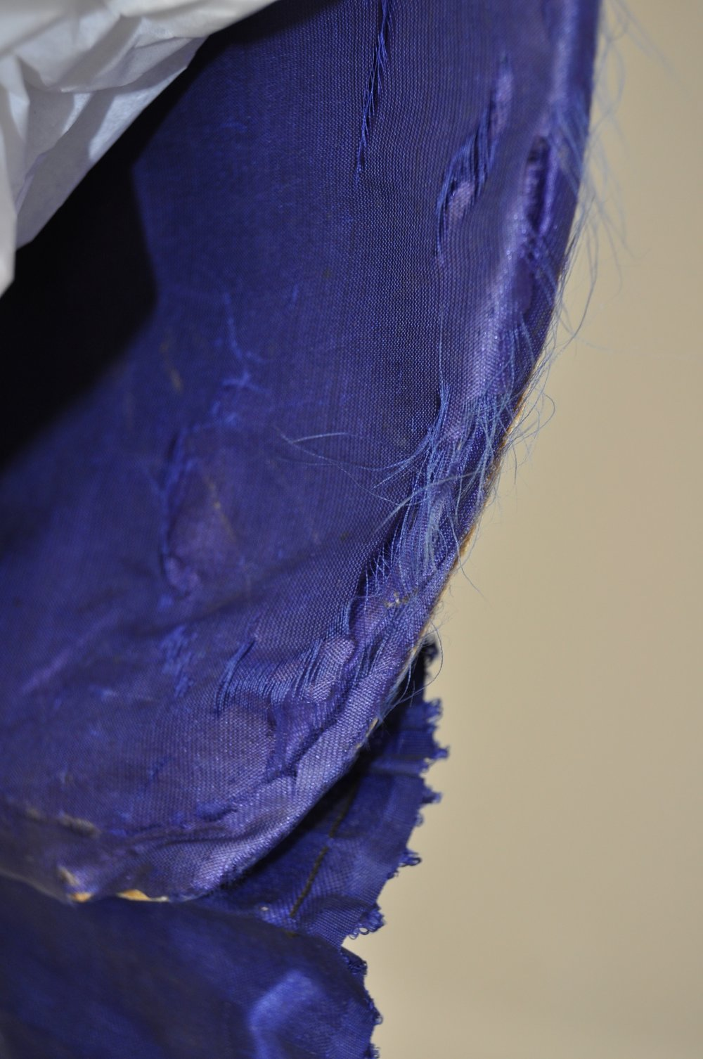 Detail of the blue silk lining, before treatment