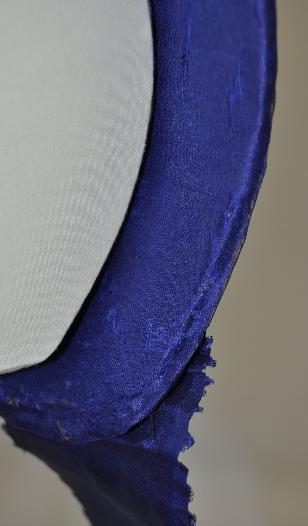Detail of the blue silk lining, after treatment