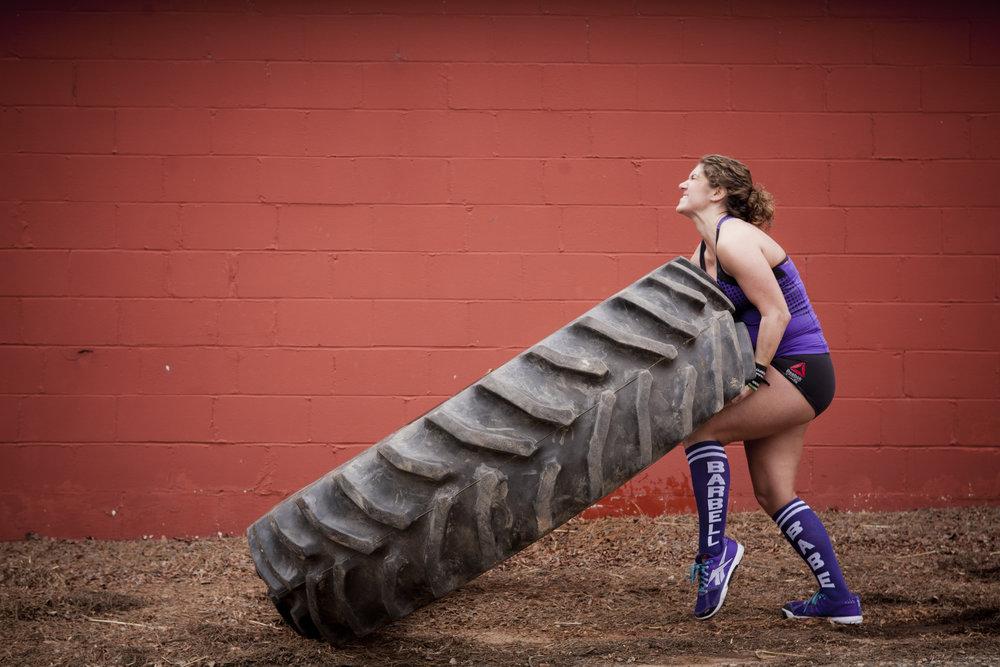 lady-lifting-tire.jpg