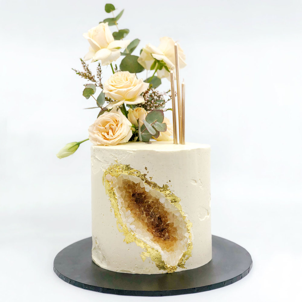 Whimsical geode and flower cake
