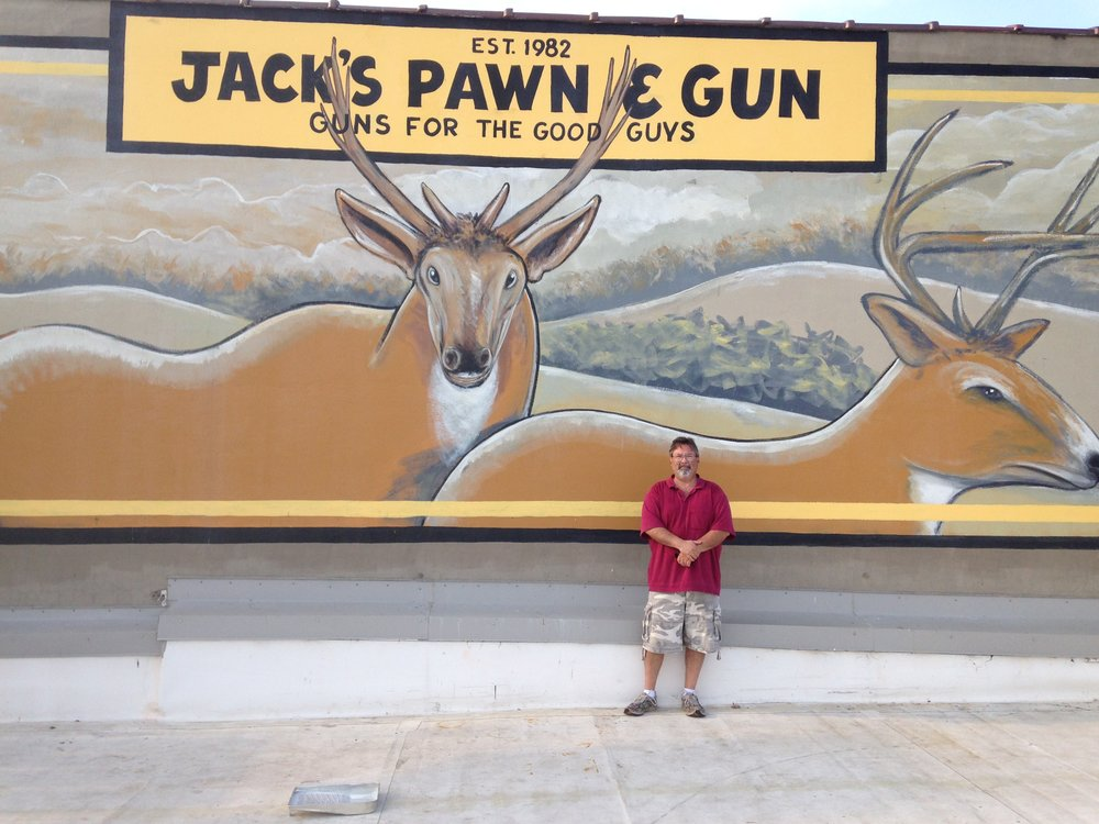 This mural is a large Mural/Sign in the city of Dalton, GA. This is the first mural from Jack's Pawn Shop. It was painted in the summer of 2013. Painted by John W. Christian