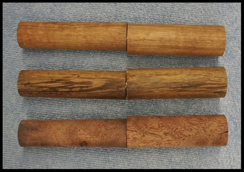 - Scott begins with raw wood that matches the color of the band itself. He then continually shapes the wood to form the pen.
