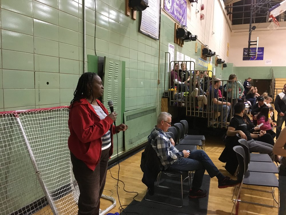 Beechwood neighbor Sandra Anderson sharing the impact 441 Ministries has had in her family at the recent basketball benefit at East High School.