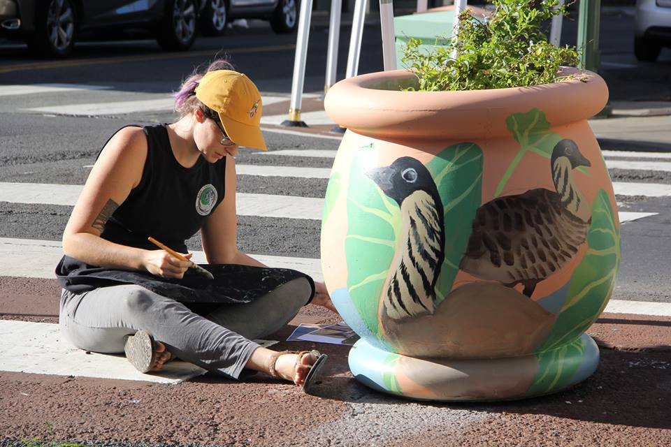 THE Arts at Marks Garage Wetland Revival Public Art Project, artist Kaleigh Chalkowski painting planters on Pauahi & Nu'uanu Street in Chinatown Honolulu Historical Arts District. A co-creative gallery, performance and community space for social enterprises and non-profit organizations aiming to transform downtown Chinatown Honolulu Arts and Cultural District through the power of the arts. - community art